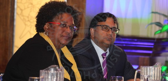Prime Minister Mia Mottley and economist Avinash Persaud during today's conference.