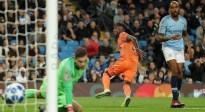 Lyon's Maxwel Cornet wheels away after scoring past City's Ederson.