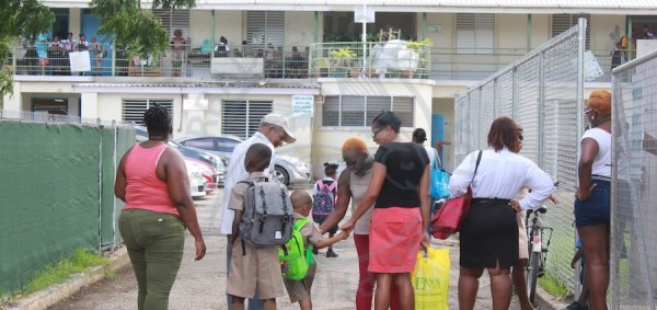 Parents escorting their children to school at Eagle Hall Primary this morning.