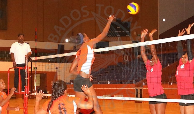 Warrens spiker Anicia Wood with a shot past Carlton's defence. (Pictures by Morissa Lindsay).