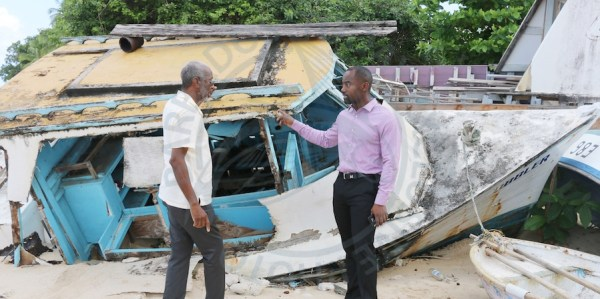 Minister of Maritime Affairs and the Blue Economy Kirk Humphrey (right) discusses with Chief Fisheries Officer Stephen Willoughby, Government's plans to clear the beaches of derelict boats.