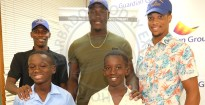 (L-r) Reynold Weekes captain RJ Gittens and Bayley's captain Reynaldo Bourne all smile as they pose with West Indies B team player Jarion Hoyte, West Indies T20 captain Carlos Brathwaite and Nicholas Kirton of Combined Campuses and Colleges.