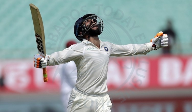 Ravindra Jadeja savours reaching his landmark against the West Indies.