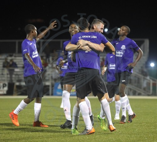 St Andrew Lions celebrate goal number two having come from behind twice against BDFSP. (Pictures by Morissa Lindsay).