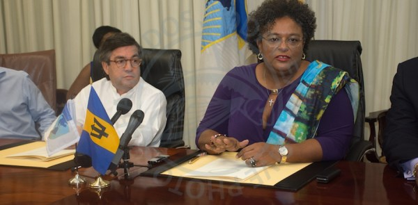 IDB president Luis Alberto (left) and Prime Minister Mia Mottley