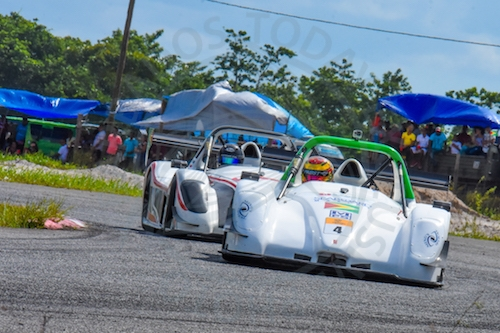 Guyana's Calvin Ming (#4), won two of Sunday's three races, and here battles with fellow-countryman Kristian Jeffrey, who was the other winner.