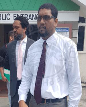 Deoraj Dalchand (right) leaving court with his attorney Ajamu Boardi (left).