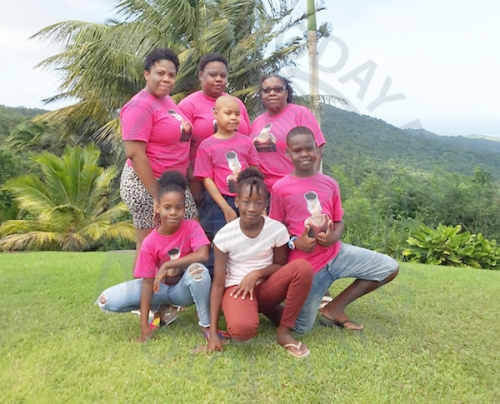 Azaria Worrell (centre) with her mother Alicia Worrell (centre at back), grandmother Mary Worrell (right, at back), aunt Akylia Worrell (left at back), twin sister Lazaria (left at front), brother Kaegan (right), and god-sister Jekayla Beckles, at a recent family outing.