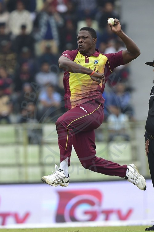 Man-of-the-Match fast bowler Sheldon Cottrell sends down a delivery during Monday's opening T20 International.