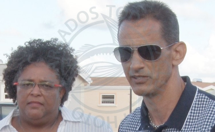 Prime Minister Mia Mottley (left) and Coverley developer Mark Maloney during a recent tour.