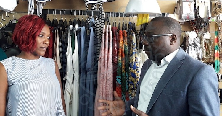 Minister of Small Business, Entrepreneurship and Commerce Dwight Sutherland speaking with Naquita Alexander, owner of La Flam's Clothing Store today.