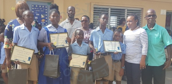 Reynold Weekes Primary School students (from left) Jaquon Blackman-Gittens, Natalia Leon Blackman, Jerome Forde and Nathan Blackman were rewarded today for their good deed.