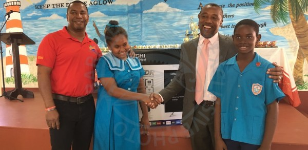 Minister of Energy and Water Resources Wilfred Abrahams (left) and representative for Christ Church South Ralph Thorne with St Christopher Primary School headgirl Trinity John-Trotman and headboy Shaquan Ellis.