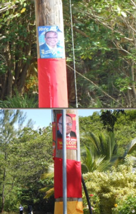 The posters of DLP candidate John Boyce and BLP Jerome candidate guard the area