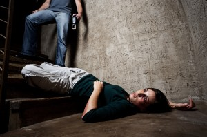 bigstock-Battered-woman-lies-lifelessly-27172106