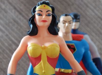 Wonder Woman heroine standing tall in front of Superman and Batman
