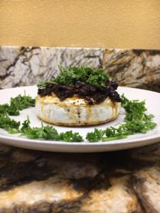 Easy baked brie with sun dried tomatoes and parsley