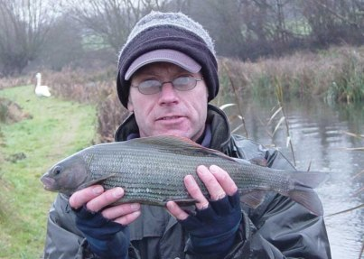 Andy with the largest of three 2 lbs+ grayling caught from the River Dever in December 2005. This one weighed 2.09.