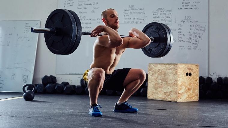 Man front squatting