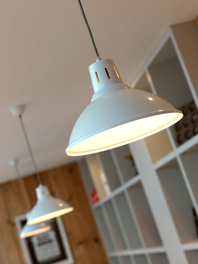 Pale pendant lamps light the sitting room