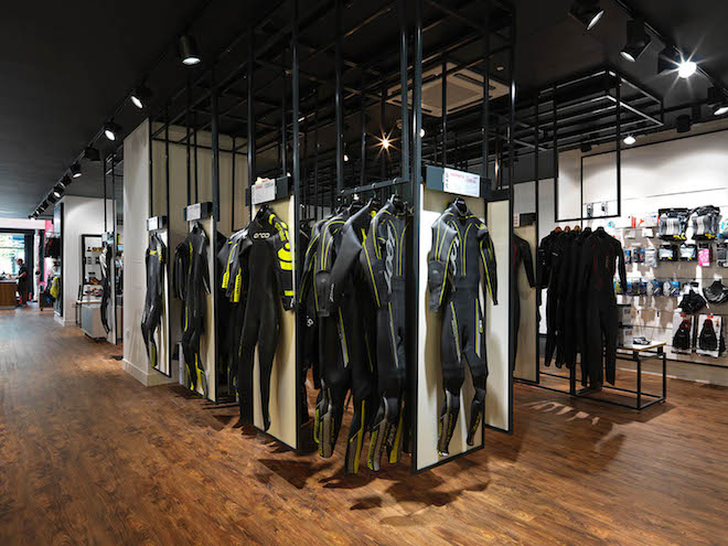 Trisuits hang in the retail interior