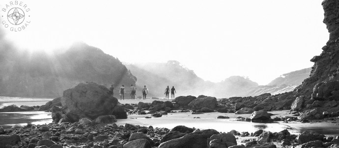 Surfers on Bethells Beach, New Zealand