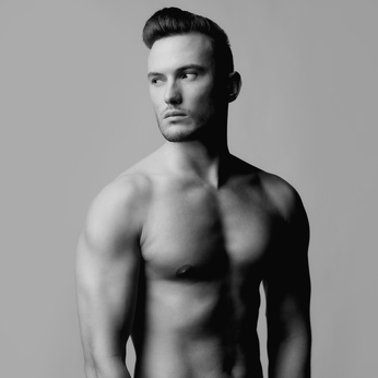 Fashion photo of naked male with strong body