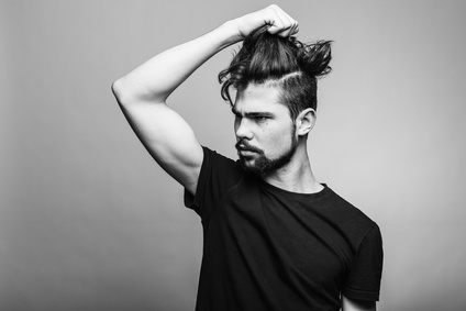 Young man in black T-shirt with fashionable hairstyle