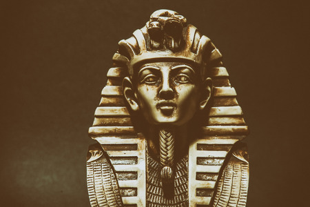 54570346 - stone pharaoh tutankhamen mask on dark background