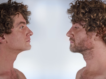 44229910 - half shaved man looking at himself with and without a beard