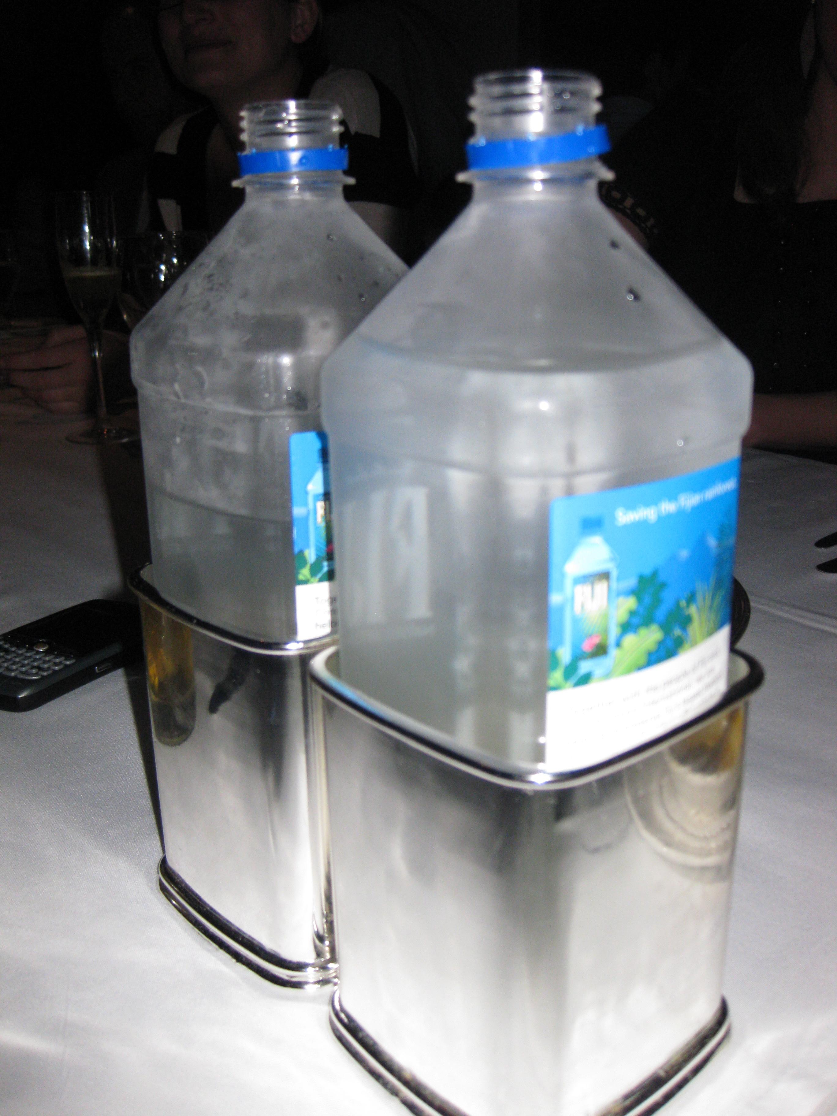 two sterling silver fiji water holders
