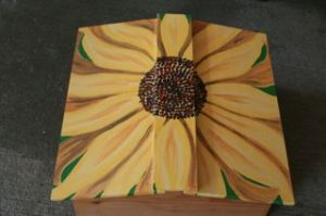 Roof of Warre Hive painted with a sunflower