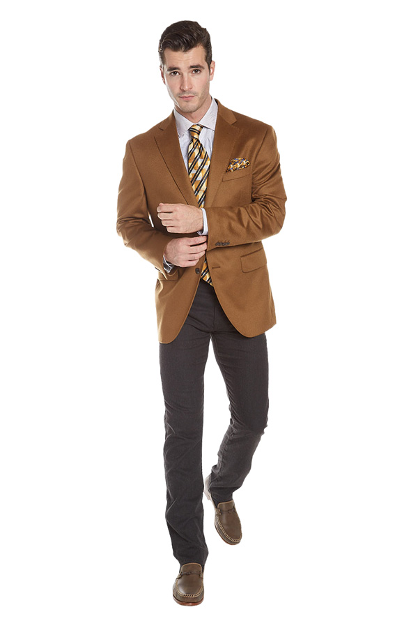 man in a light cocoa brown suit jacket