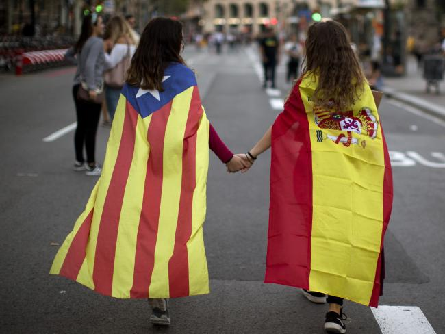 Catalan and Spanish flags holding hands