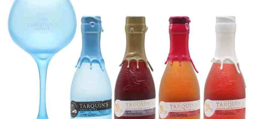 4 different small bottles of Tarquin's gin with a big blue copa glass
