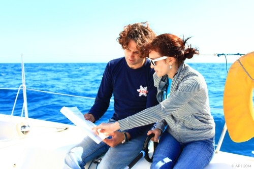 Learning to navigate at Barcelona sailing tours, reading the chart.