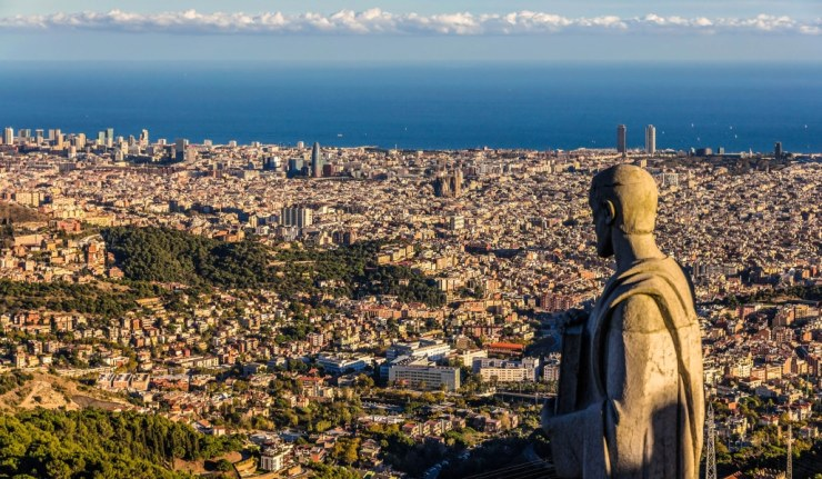 Sculpture of Apostle and view of Barcelona