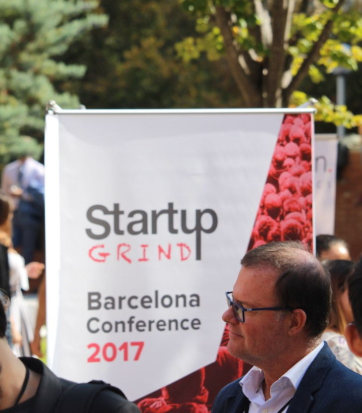 Attendees wait in line for coffee at Startup Grind Conference in Barcelona