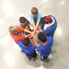 Here is another example of a fun and interactive mathematical warm up. The students pictured attempt to conquer the human knot: a topologically based activity.