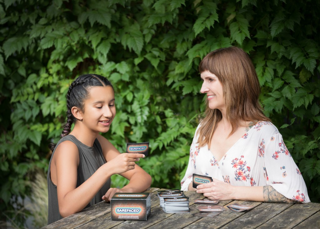 Nyssa and girl playing game
