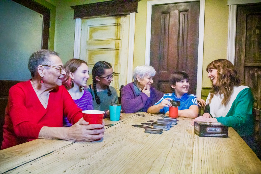 Grandparents and teens playing barefaced comprehensive sex ed game