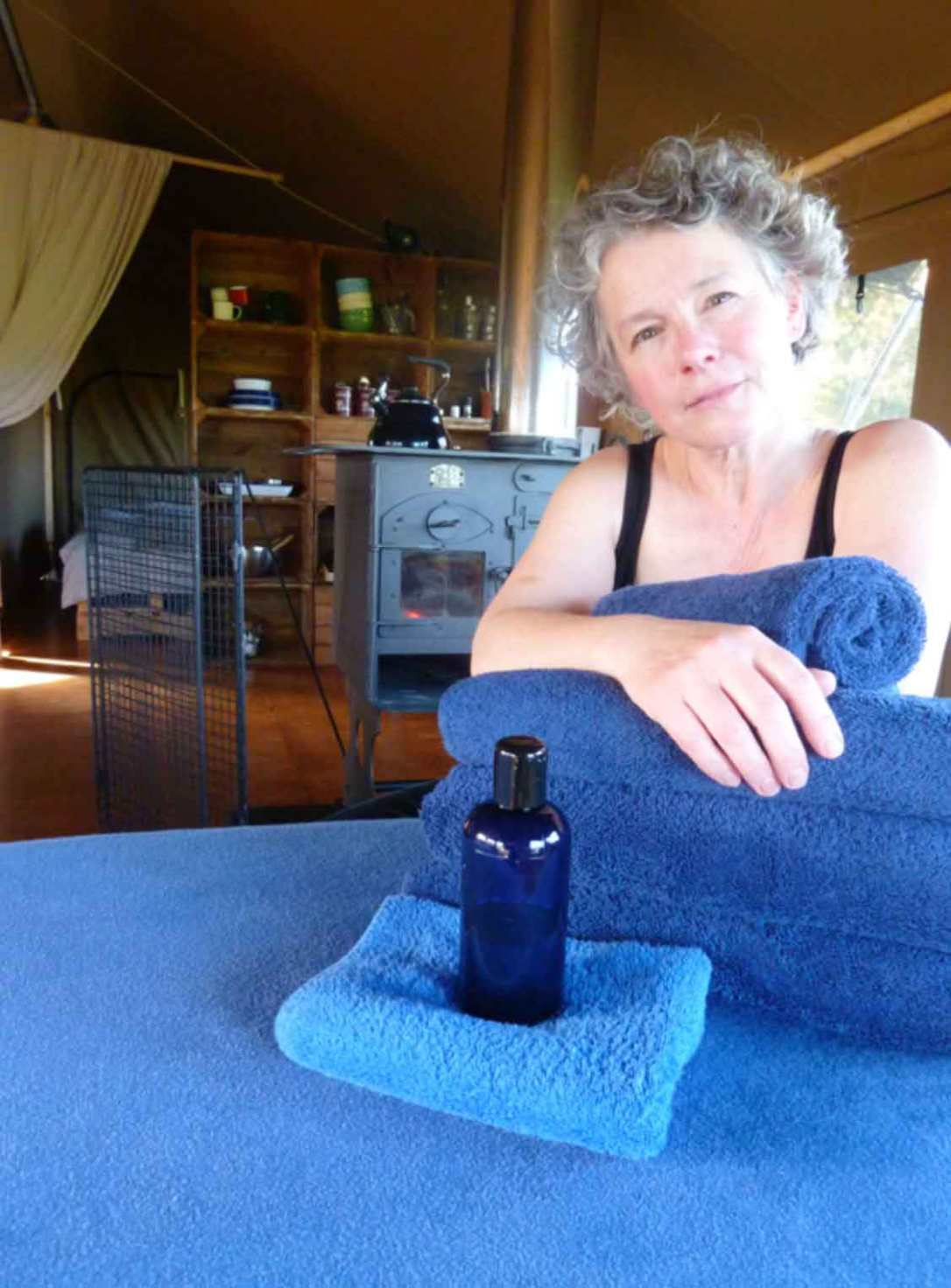 Anthea Bowen massage practitioner inside a safari tent at barefoot glamping Cornwall