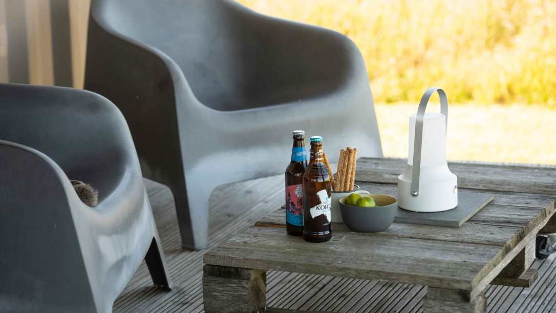 Relax with beers and snacks on Rusty the tin tent decking