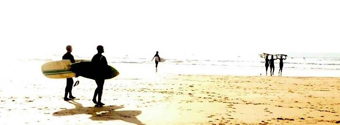 surfing at the nearby beach with friends