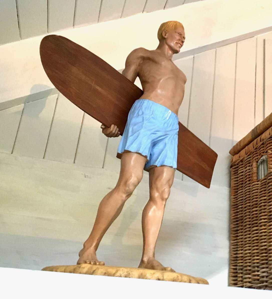 a vintage surfer statue