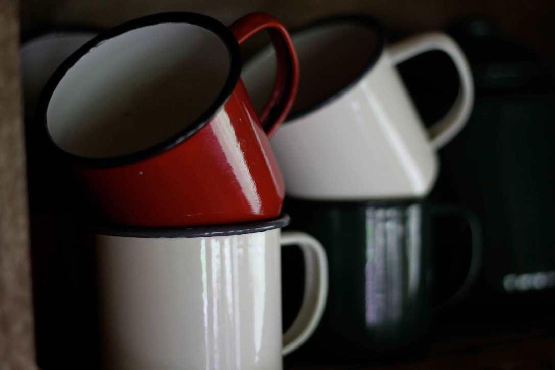 enamel mugs in the safari tent kitchen