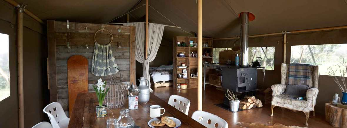 the large open plan living area inside hobie the safari tent