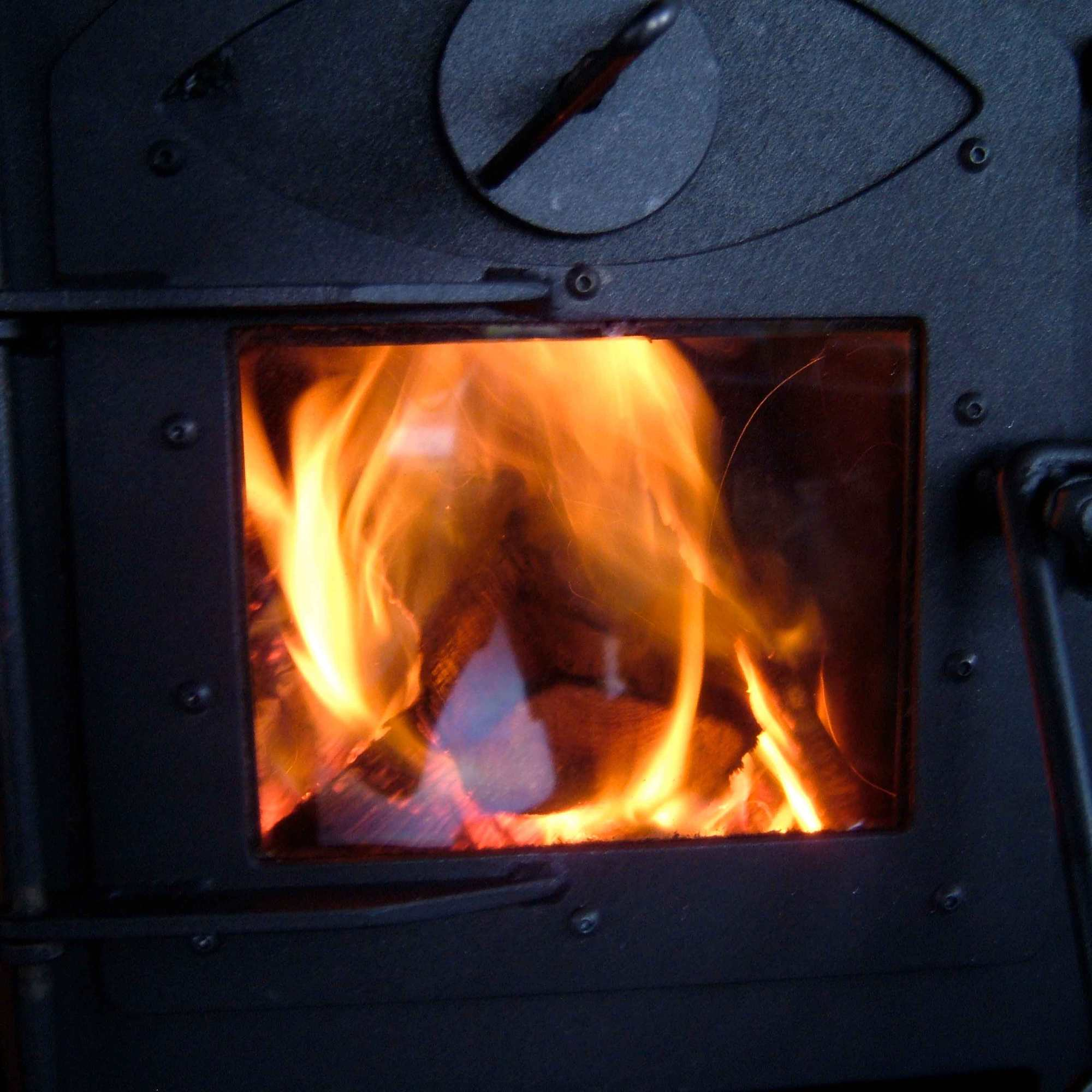 close up of a roaring fire in the wood stove