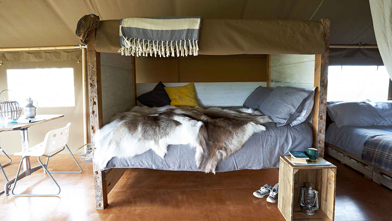 one of the handmade day beds in the safari tents