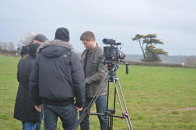 George Clarke standing by the tv film crew at barefoot glamping Cornwall